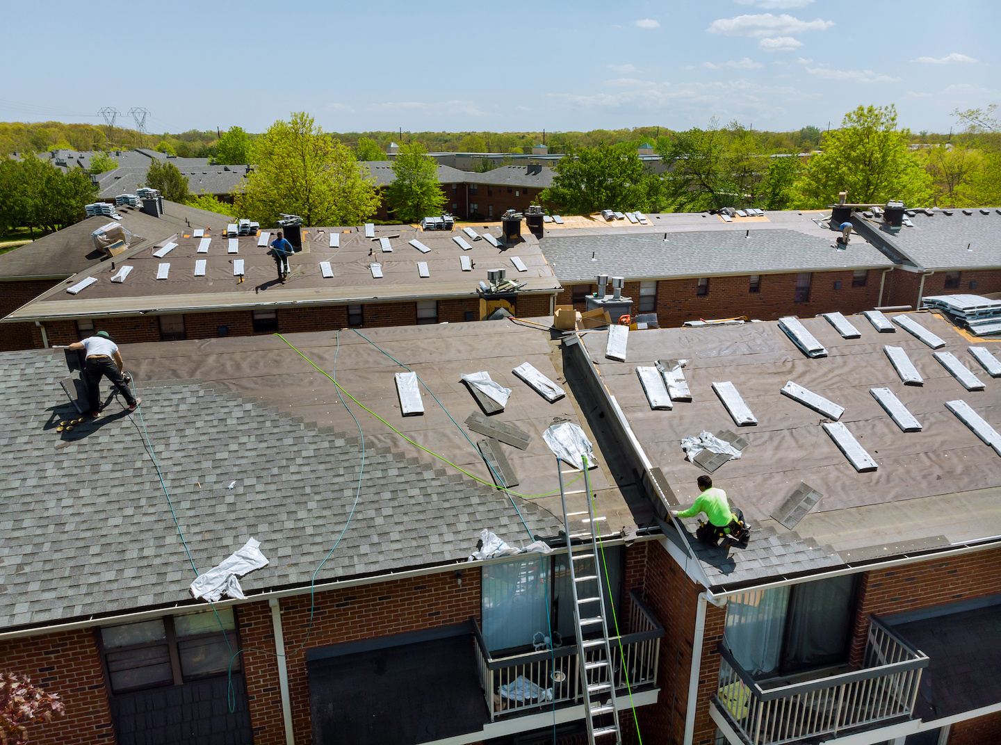 Men Working on Commercial Roof Maintenance